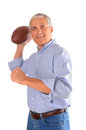 Middle aged businessman throwing football Stock Photo