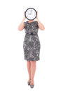 Middle aged businesswoman with clock covering face isolated on white background Stock Photography