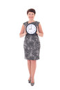 Middle aged businesswoman holding clock isolated on white background Royalty Free Stock Images