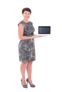 Middle aged businesswoman showing laptop with blank display isolated on white background Stock Images