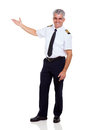 Middle aged captain cheerful showing empty space on white background Royalty Free Stock Photography