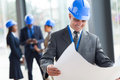 Middle aged construction manager happy in office Stock Images