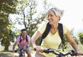 Middle Aged Couple Cycling Through Countryside Royalty Free Stock Photo