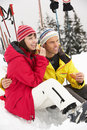 Middle Aged Couple Eating Sandwich On Ski Holiday Royalty Free Stock Photo