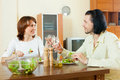 Middle aged couple eating vegetarian salad with clean water at h happy home Royalty Free Stock Photography