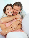 Middle aged couple embracing each other at home Stock Image