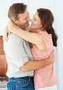 Middle aged couple embracing each other at home Royalty Free Stock Photo