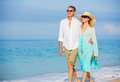 Middle aged couple enjoying walk on the beach happy romantic vacation retirement concept Royalty Free Stock Photography