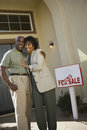 Middle aged couple in front of new home Royalty Free Stock Photo