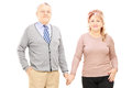 Middle aged couple holding hands and posing Royalty Free Stock Photo