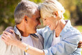 Middle aged couple loving hugging with eyes closed closeup portrait Royalty Free Stock Photos