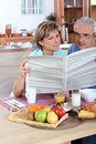 Middle-aged couple reading Stock Images