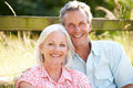 Middle aged couple relaxing in countryside close up of smiling at camera Stock Image