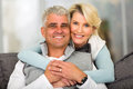 Middle aged couple relaxing happy loving at home Royalty Free Stock Photos