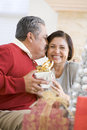 Middle Aged Couple Sitting And Holding Christmas Stock Photography