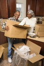 Middle-aged couple unpacking boxes. Stock Image