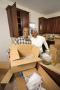 Middle-aged couple unpacking boxes. Stock Photography