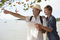 Middle aged couple on vacation with map sightseeing search the way Royalty Free Stock Photos