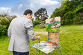 Middle-aged fashionable male painter mixing colors Royalty Free Stock Photo