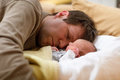 Middle aged father cuddling with his newborn baby daughter Royalty Free Stock Photo