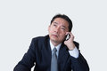 Middle aged guy in trouble on the phone at office Royalty Free Stock Image