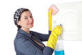 A middle aged housekeeper cleans the interior close up Royalty Free Stock Image