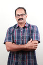 A middle aged indian with folded hands portrait of Royalty Free Stock Photos