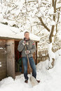 Middle Aged Man Clearing Snow From Path Stock Photography