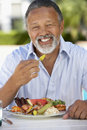 Middle Aged Man Dining Al Fresco Royalty Free Stock Photos