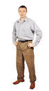 Middle-aged man dressed in trousers and grey shirt Royalty Free Stock Image