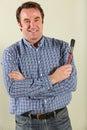 Middle Aged Man Holding Paintbrush Stock Image