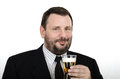 Middle aged man holds a lager glass bearded in black suite on white background Stock Image
