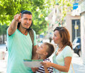Middle-aged man pointing the direction for family Royalty Free Stock Photo