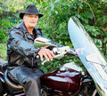 Middle-Aged Man Riding Motorcycle Stock Photography