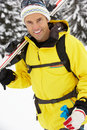 Middle Aged Man On Ski Holiday In Mountains Royalty Free Stock Image