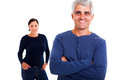 Middle aged man wife smiling men with arms folded with his on background Royalty Free Stock Photos