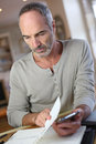 Middle aged man working from home mature Stock Photo