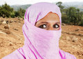 Middle aged muslim woman in pink portrait of serious with scarf or hijab Stock Photography