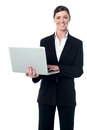 Middle aged professional woman with laptop corporate lady working on and looking at camera Stock Photo