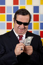 Middle aged repulsive businessman counting showing off his money Royalty Free Stock Photo