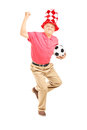 Middle aged sport fan with hat holding a ball and gesturing happ full length portrait of soccer happiness isolated on white Stock Image