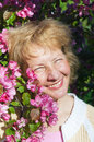 Middle-aged woman in a blossoming magnolias Royalty Free Stock Photography