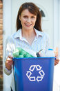 Middle Aged Woman Carrying Recycling Bin Royalty Free Stock Photo