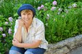 Middle-aged woman gardening Stock Photos