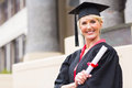 Middle aged woman graduation happy with cap and gown holding diploma Royalty Free Stock Photos