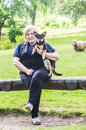 Middle aged woman and her dog with on an old wooden bench Royalty Free Stock Photography