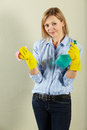 Middle Aged Woman Holding Cleaning Products Stock Photography