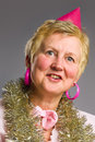 image photo : Middle-aged woman in pink party hat