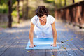 Middle aged woman push up Royalty Free Stock Image