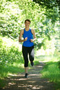Middle Aged Woman Running In Countryside Royalty Free Stock Photo